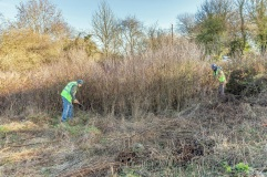 . . clearing the area between the car park and the stream. .